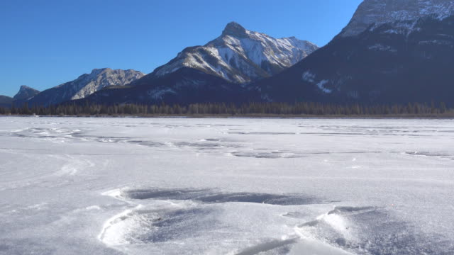 moving across a frozen mountain lake - frozen stock videos and b-roll footage