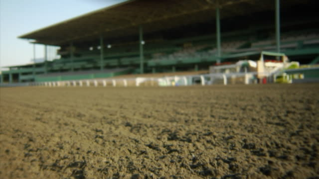 la ws ts moving across dirt on horse track toward grandstand/ usa - pferderennbahn stock-videos und b-roll-filmmaterial