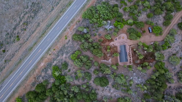 moving aerial directly above a modern tiny home in western colorado - modern rock stock videos & royalty-free footage