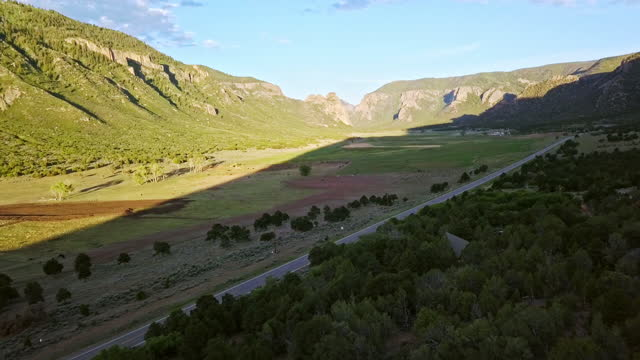 moving aerial shot of a modern tiny home along highway 141 in western colorado - modern rock stock videos & royalty-free footage