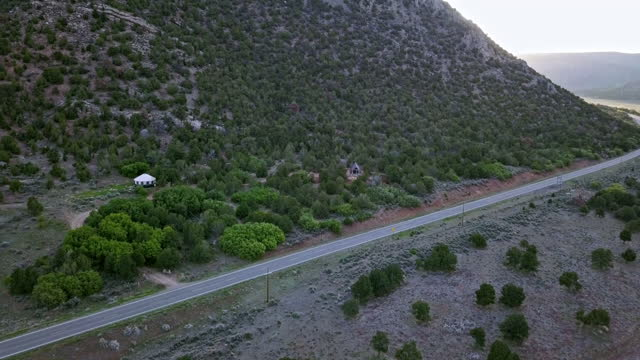 moving aerial shot of a modern tiny home and yurt along highway 141 in western colorado - modern rock stock videos & royalty-free footage
