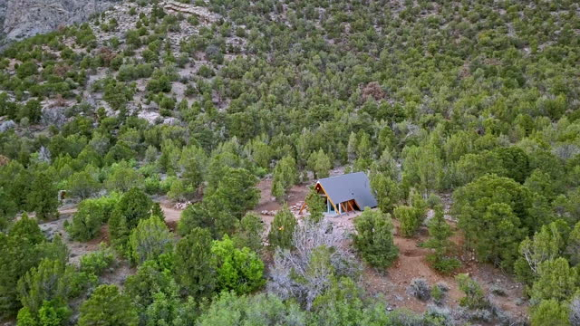 moving aerial shot of a modern tiny home in western colorado - modern rock stock videos & royalty-free footage