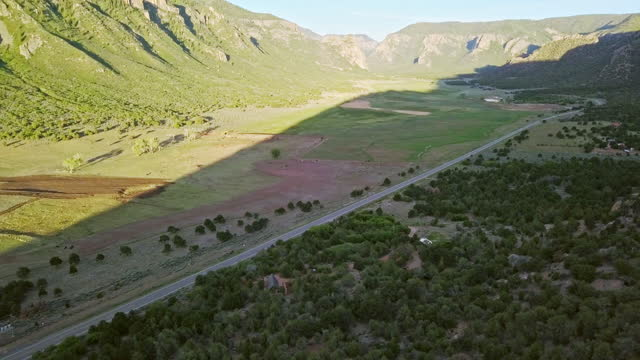 moving aerial sunrise shot of a modern tiny home along highway 141 in western colorado - modern rock stock videos & royalty-free footage
