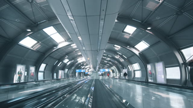moving airport escalator against sun - escalator stock videos & royalty-free footage