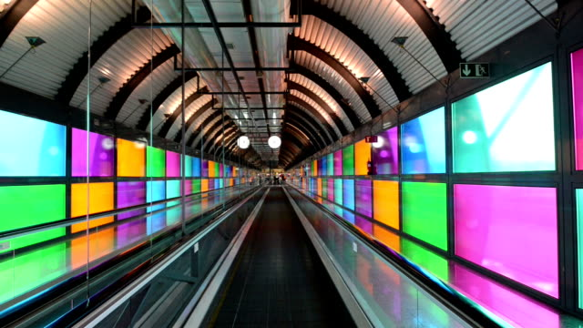 moving airport escalator in madrid, spain - tunnel stock videos & royalty-free footage