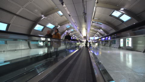 moving airport escalator - pedestrian walkway stock videos & royalty-free footage