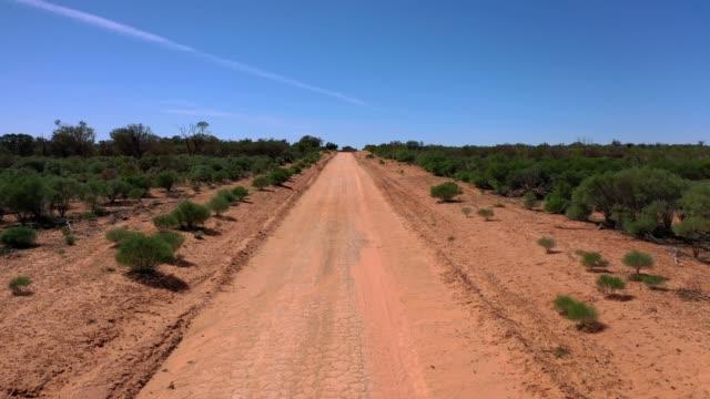 moving along dirt road, road trip in outback australia - 散歩道点の映像素材/bロール