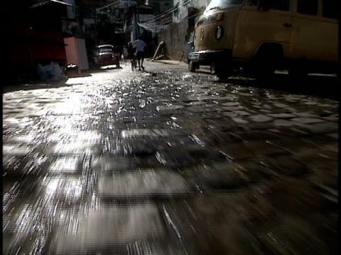 POV moving along wet cobblestone street, Rio de Janeiro, Brazil