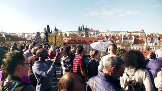 moving among charles bridge tourists in prag - hradcany castle stock videos and b-roll footage