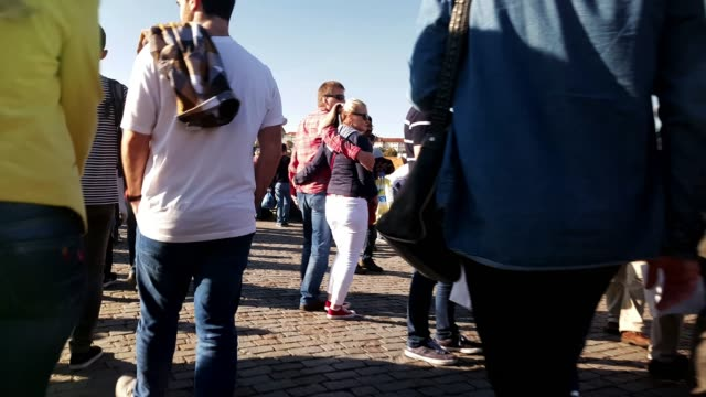moving among tourists on charles bridge in prague - prague stock-videos und b-roll-filmmaterial