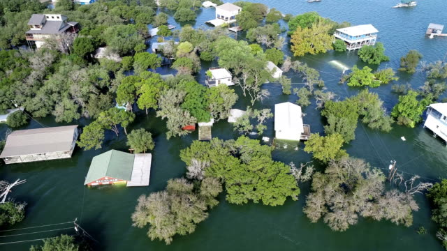 moving around entire flooded area, a disaster zone , historic flooding along colorado river leaves homes flooded and under water - greenhouse effect stock videos and b-roll footage