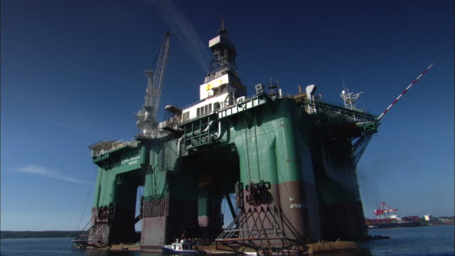pov, moving around oil rig, halifax, nova scotia, canada - crane construction machinery stock videos & royalty-free footage