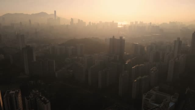 moving back and tilt up of hong kong skyscraper in sunset time. - tilt stock videos & royalty-free footage