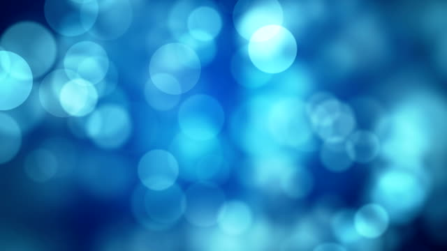 moving blue glitter lights, defocused light reflections loopable bokeh background - scintillante video stock e b–roll