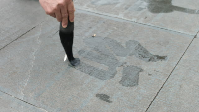 moving calligraphy brush