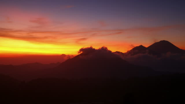 moving clouds at sunrise in kintamani in bali - bali stock videos & royalty-free footage