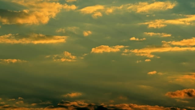moving clouds at sunset (hd 1080) - stratocumulus stock videos and b-roll footage