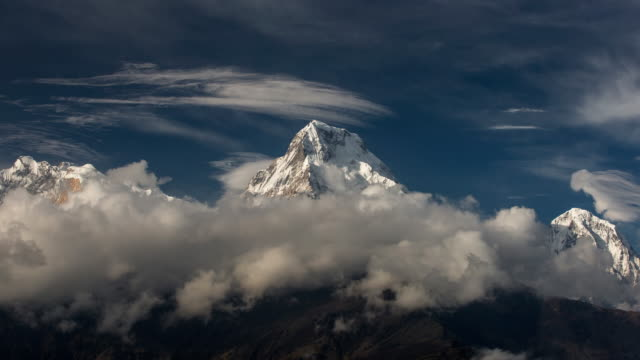 Moving clouds over Annapurna South in Himalaya Mountains, Nepal