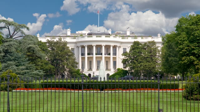 ms t/l moving clouds over white house in washington / washington / district of columbia. usa - lawn stock videos & royalty-free footage