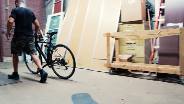 moving day - unloading bike - 4k - freight elevator stock videos & royalty-free footage