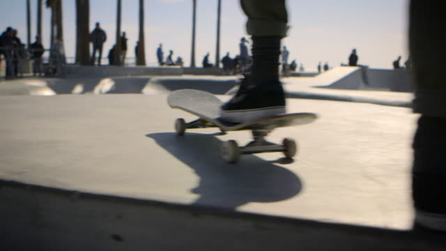 moving dolly shot of venice skatepark behind railings venice california - sports ramp stock videos and b-roll footage