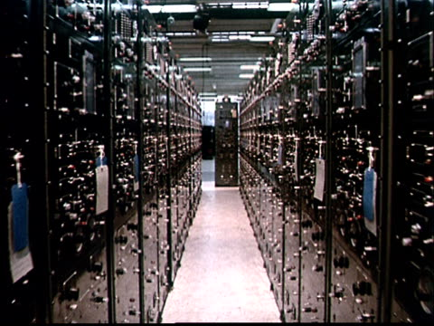 stockvideo's en b-roll-footage met 1970 ts moving down aisle between rows of computer equipment - prelinger archief