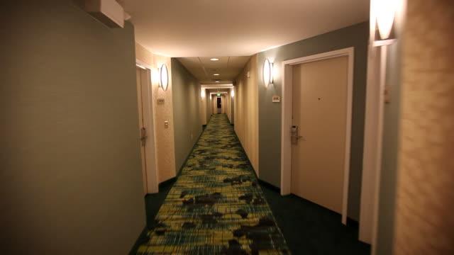MS POV Moving down hotel hallway / Wickenburg, Arizona,USA