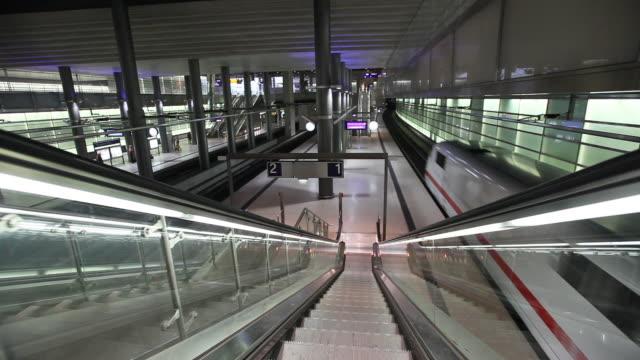 pov moving down on escalator in underground railway station, berlin, germany - rolltreppe stock-videos und b-roll-filmmaterial