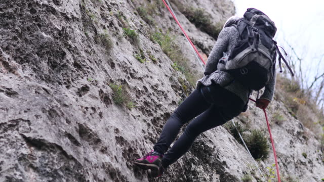 moving down on the cliff - abseiling stock videos & royalty-free footage
