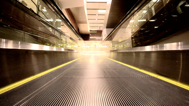 moving empty travelator in a building - diminishing perspective stock videos & royalty-free footage