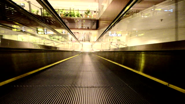 moving empty travelator in a building - conveyor belt stock videos and b-roll footage