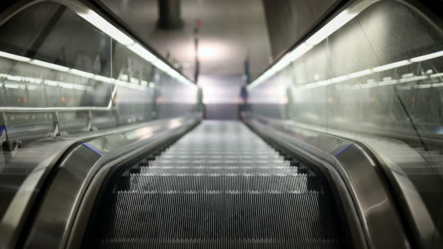 moving escalator + audio - leben in der stadt stock videos & royalty-free footage