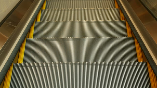 moving escalator down - stair lift stock videos and b-roll footage