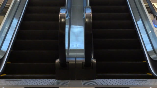 moving escalator up and down - stair lift stock videos and b-roll footage