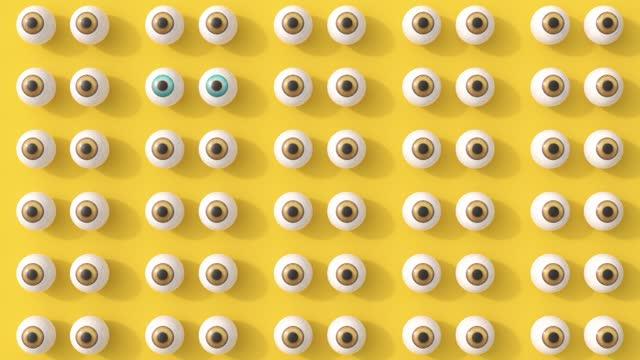 moving eyes on yellow background - variation bildbanksvideor och videomaterial från bakom kulisserna