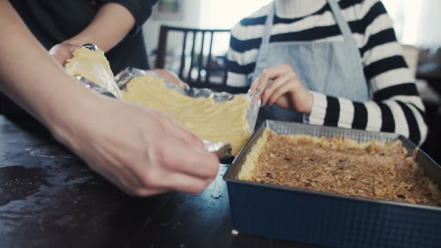 moving flattened dough to baking tray - baking tray stock videos & royalty-free footage