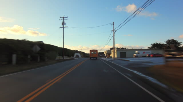 stockvideo's en b-roll-footage met moving forward: following a yellow truck - following moving activity