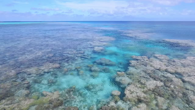 Moving forward over coral lagoon and turquoise waters