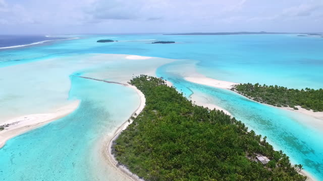 moving forward over one foot island with aitutaki lagoon behing - aitutaki lagoon stock videos & royalty-free footage