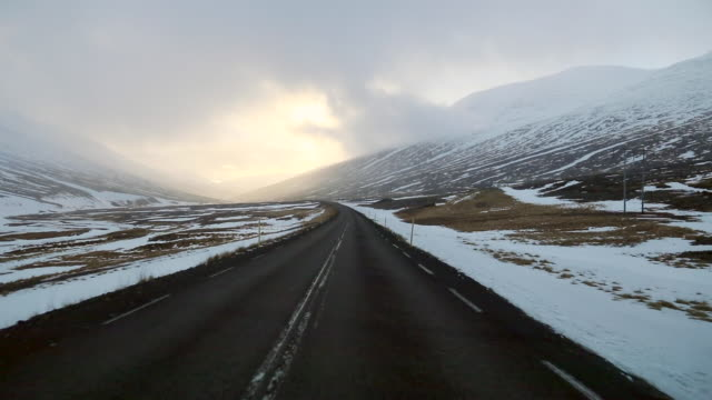 moving forward: road trip view of east fjords - storm cloud stock videos & royalty-free footage
