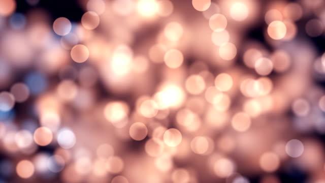 stockvideo's en b-roll-footage met bewegende glitter lichten, defocused lichtreflecties loop bare bokeh achtergrond - langzaam