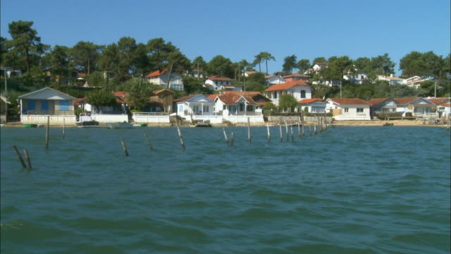 side pov, moving in arcachon bay along oyster park and fishing village, aquitaine, france - arcachon stock videos and b-roll footage