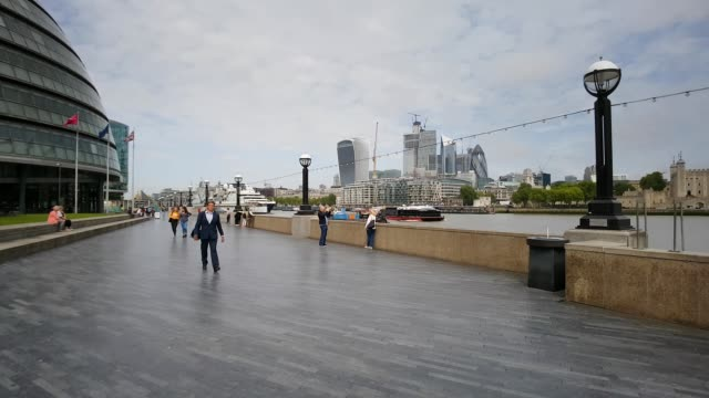 moving in the queen's walk at london city hall - pedestrian zone stock videos & royalty-free footage