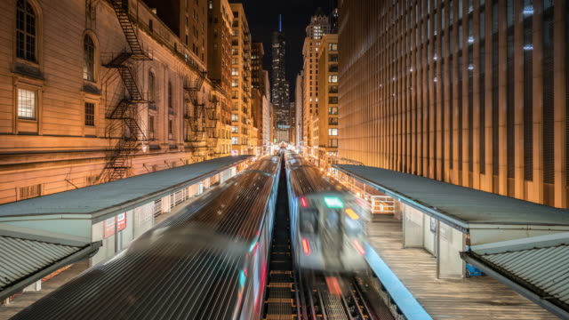 t/l ws moving metro trains at night / chicago, usa - chicago 'l' stock videos & royalty-free footage