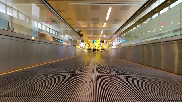 moving on automatic long escalator walkway in the airport - entrance sign stock videos & royalty-free footage
