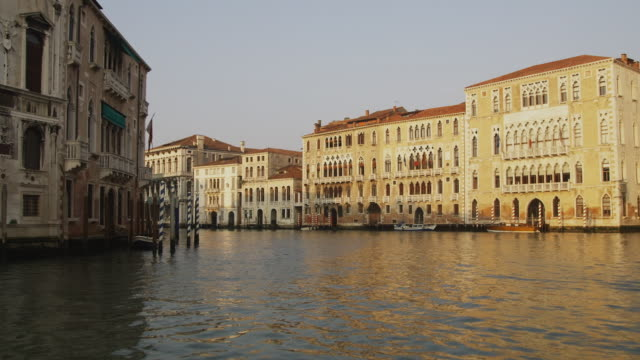 pov, moving on grand canal at dawn, venice, italy - canal stock videos & royalty-free footage