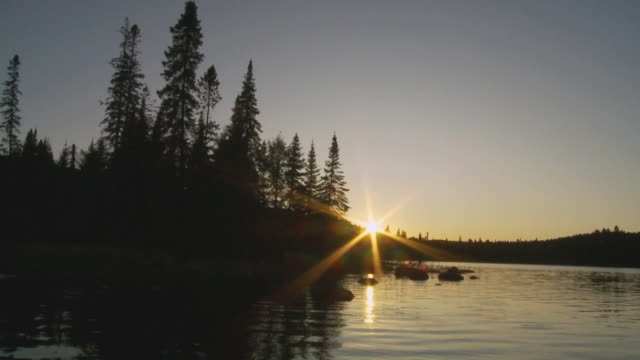 slo mo rear pov moving on lake opeongo at sunset, algonquin park / whitney, ontario, canada - ontario canada stock videos & royalty-free footage