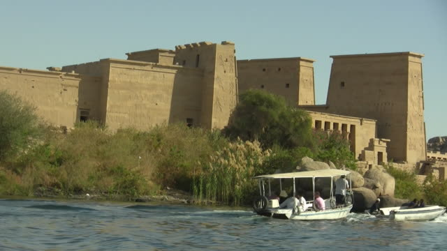 side pov, moving on nile river along temple of isis, philae island, egypt - naga river stock videos and b-roll footage