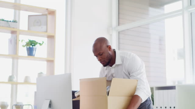 moving on the bigger and better things - moving office stock videos & royalty-free footage