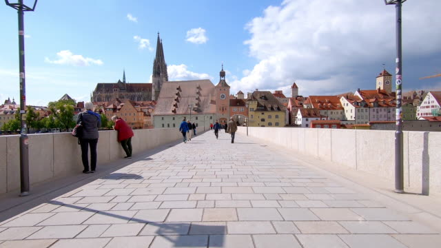 moving on the old stone bridge in regensburg - dolly shot stock videos & royalty-free footage
